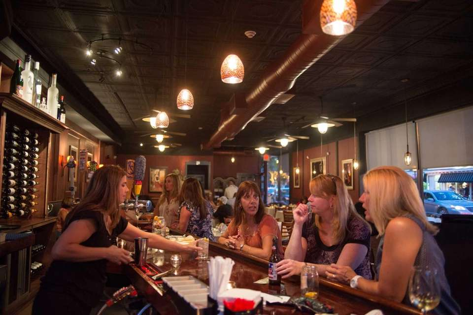Patrons sip drinks and eat in the spacious