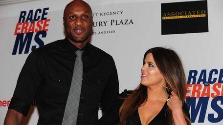 Lamar Odom and Khloe Kardashian-Odom arrive for the