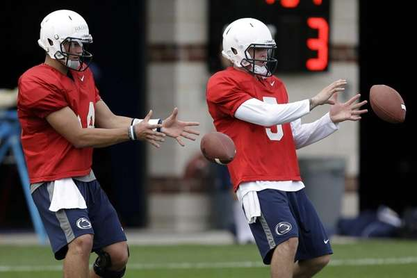 Penn State quarterbacks Tyler Ferguson, right, and Christian