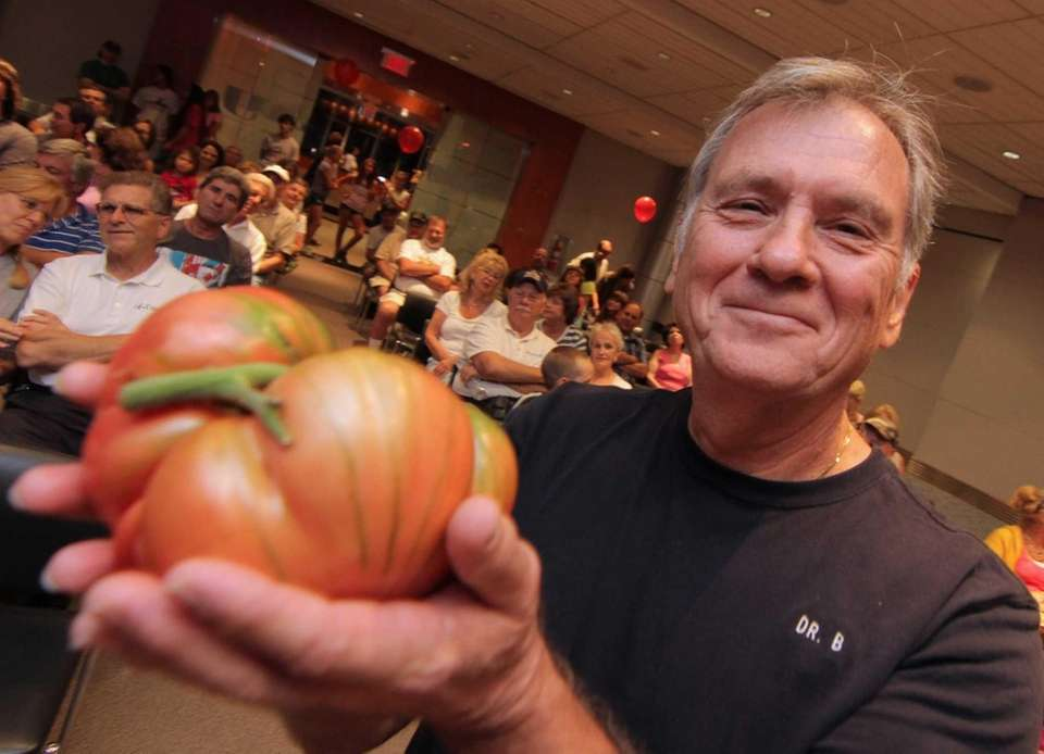 The Tomato King: William Bouziotis of Northport holds
