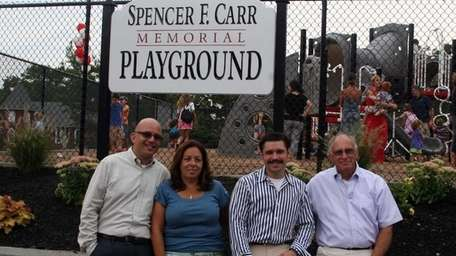 From left, family friend Ron Kaye, Alma Carr,