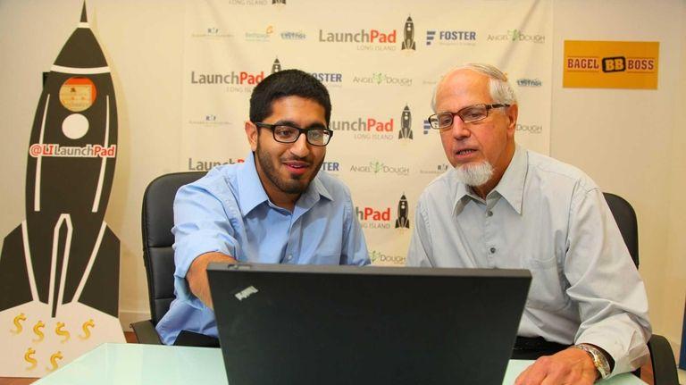 LISTnet's Peter Goldsmith looks on as Farjad Fazli,