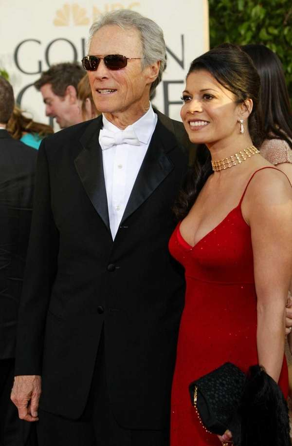 Clint Eastwood arrives with wife Dina Eastwood at