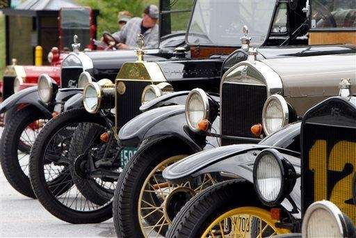Classic Model T Ford automobiles line up at