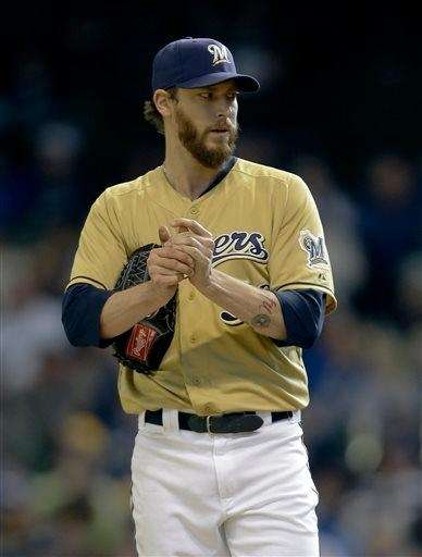 Brewers reliever John Axford has been traded to