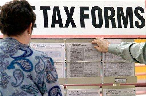 Tax payers search through tax forms at the