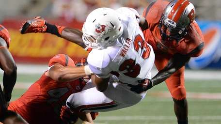 Rutgers' Kevin Snyder, left, and Gareef Glashen, right,