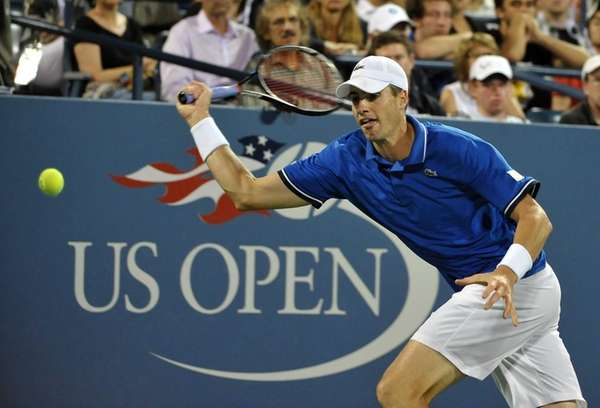 John Isner of USA runs for the ball