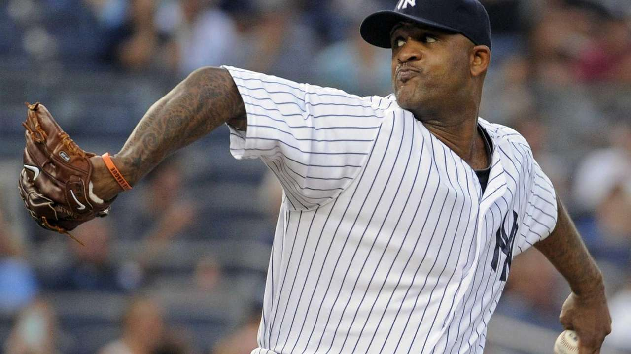 Yankees pitcher CC Sabathia delivers the ball to