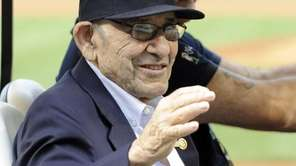 Yankees Hall of Fame catcher Yogi Berra waves