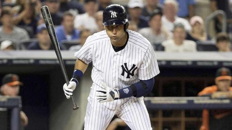 Yankees' Derek Jeter warches a foul ball in