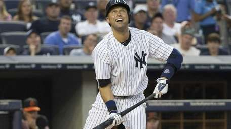 Derek Jeter watches a foul ball in the