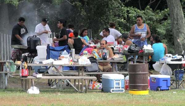 People have a barbeque at Sunken Meadow State