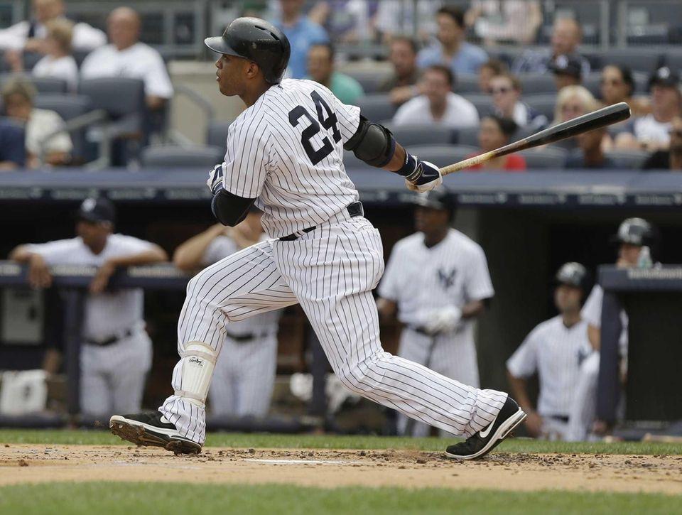 Yankees' Robinson Cano follows through with an RBI