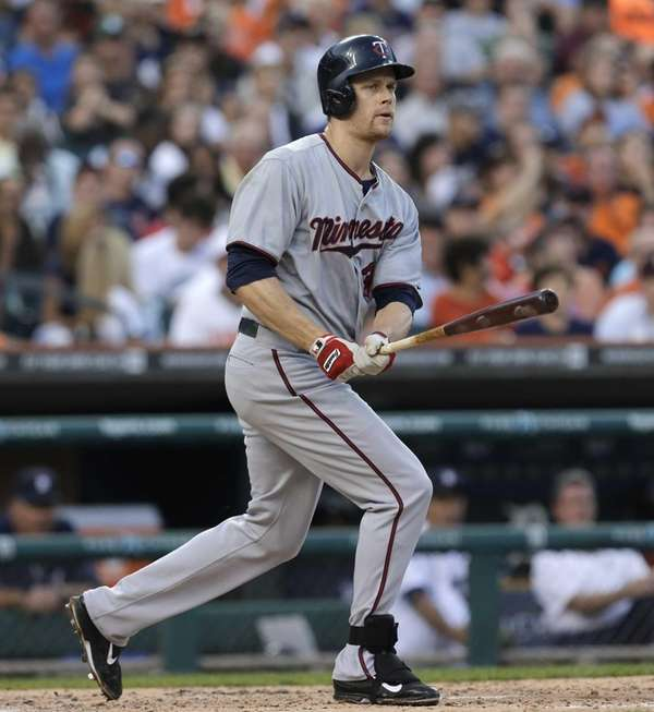 Minnesota Twins' Justin Morneau watches his two-run home