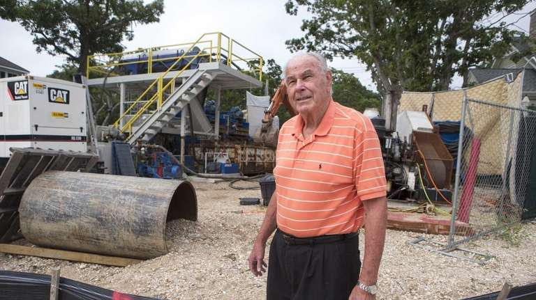 Robert Swing, of Southold, stands near a drilling