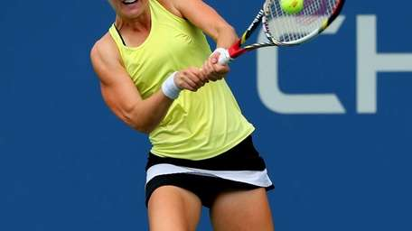 Alison Riske of the United States plays a
