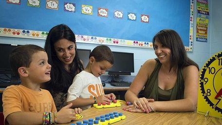 Wantagh Elementary Schools kindergarten teacher Jenny Jencius, right,