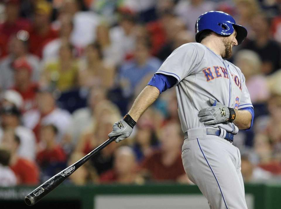 Mets' Ike Davis reacts after batting against the