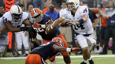 Penn State quarterback Christian Hackenberg slips away from