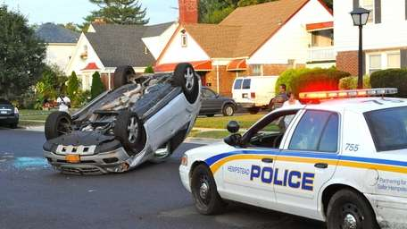 A sport-utility vehicle crashed into two parked cars,