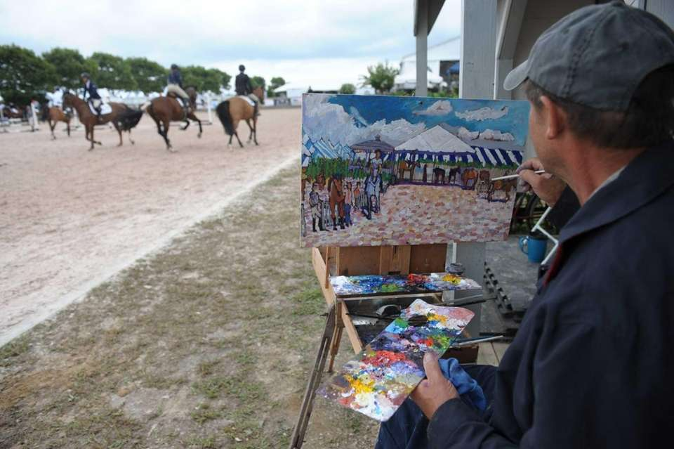 Artist Randy Smith paints a scene of the