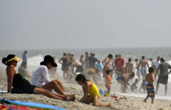 Beachgoers enjoy time on the beach at Robert