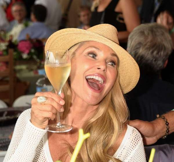 Christie Brinkley toasts at the 38th Annual Hampton