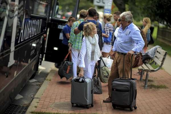 Passangers prepare to board the Hampton Jitney in