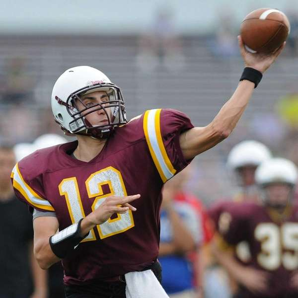 Bay Shore quarterback Ryan Mazzie throws a pass