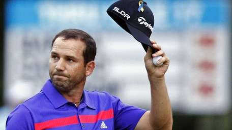Sergio Garcia, of Spain, tips his cap after