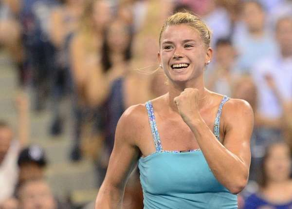 Italian tennis player Camila Giorgi celebrates winning against