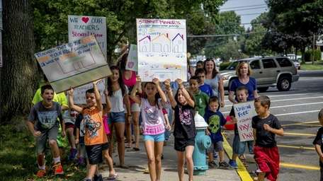 Parents and students demonstrate against a plan to