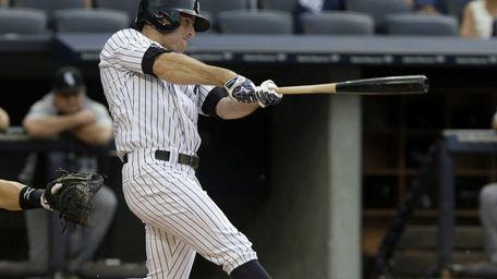 New York Yankees' Brett Gardner hits a ground