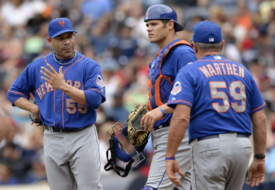 New York Mets relief pitcher Pedro Feliciano, left,