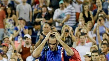 Roger Federer, of Switzerland, walks off the court