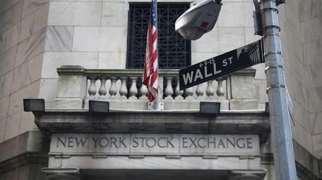 The New York Stock Exchange stands on Wall
