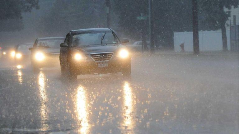 Heavy rain falls on Park Avenue in Huntington.