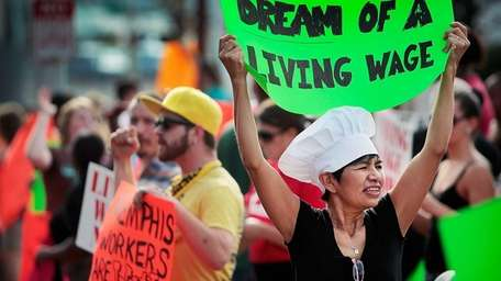 Christina Condori joins a crowd of fast-food workers