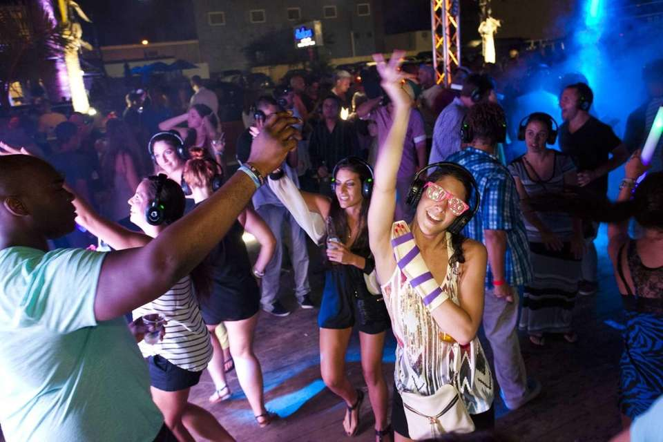 Kim Jernick, 26 of Babylon, dances to music