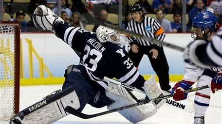 Yale goalie Jeff Malcolm (33) cannot stop a