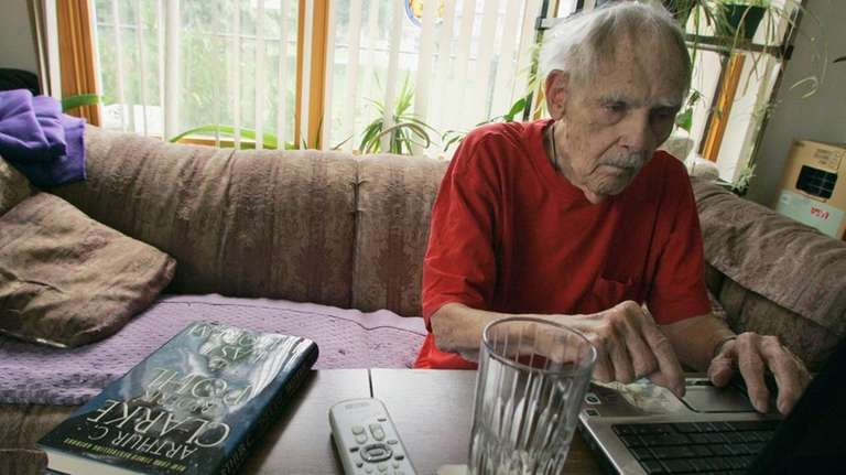 Science fiction writer Frederik Pohl works on his