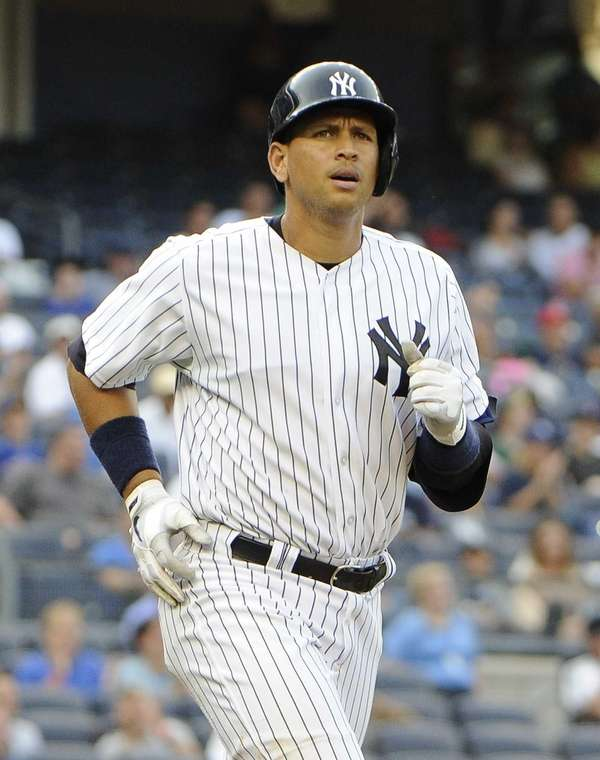 Alex Rodriguez runs to first base after drawing