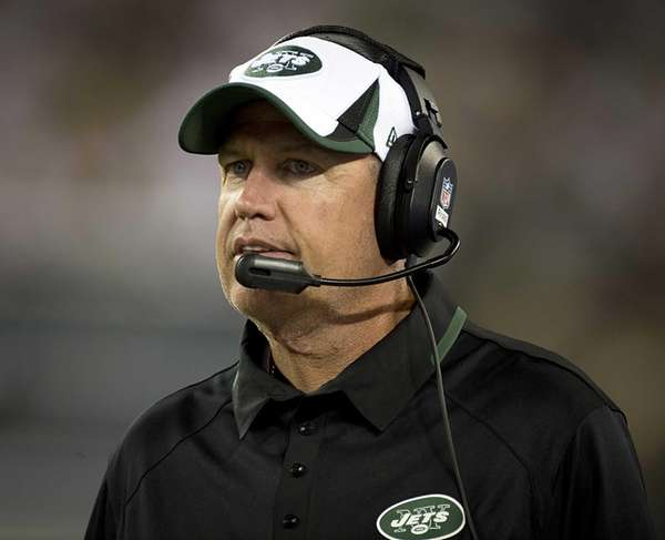 Rex Ryan stands on the sidelines during a