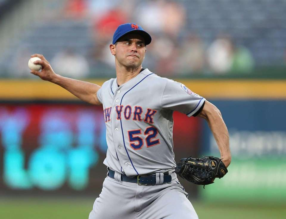 Carlos Torres delivers a pitch during a game