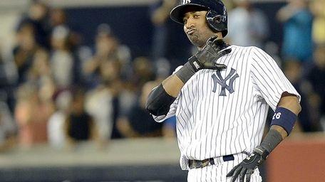 Eduardo Nunez reacts on second base after knocking
