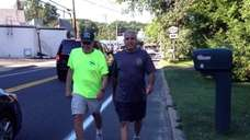 Barry Aronowsky, 72, of Greenlawn, left, and Greg