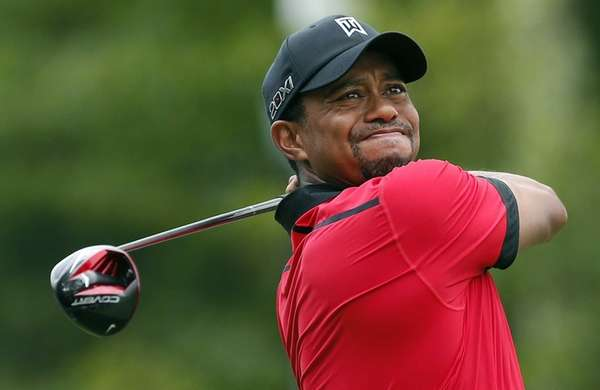 Tiger Woods tees off on the 12th hole