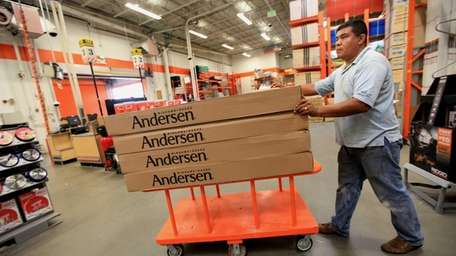 Arturo Zevila, picking up windows at Home Depot