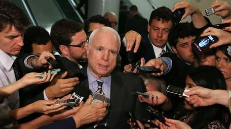Sen. John McCain talks to reporters after leaving